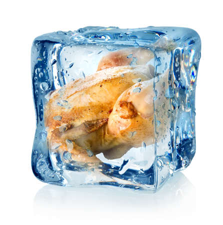 Roasted chicken in ice cube isolated on a white background photo