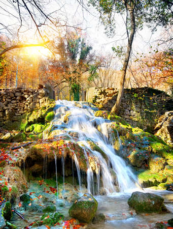 Autumn waterfall in the mountains of Crimea photo
