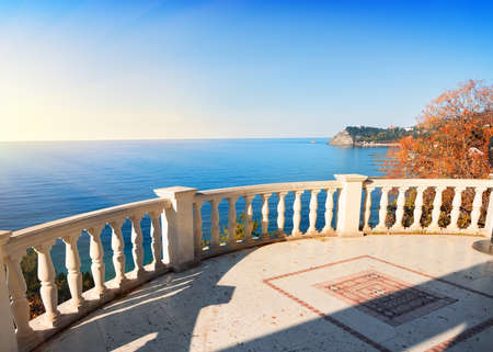 balustrade: Observation deck over the sea in sunny autumn day Stock Photo