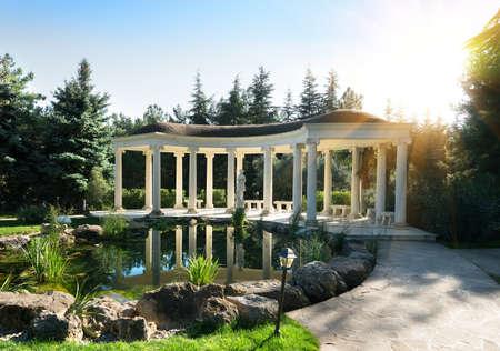 balustrade: Beautiful rotunda in a park near a little pond