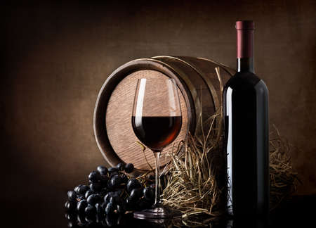 wine barrel: Wine with wooden barrel, hay and grape Stock Photo