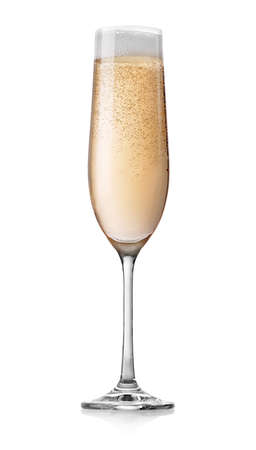 Champagne with bubbles in a glass isolated on white photo