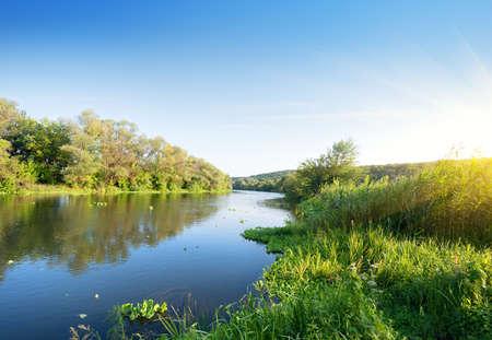 Beautiful silent summer river under the evening sun
