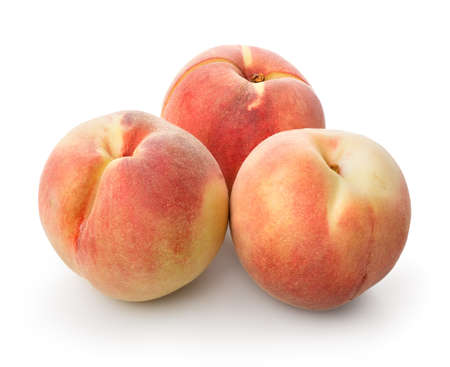 Three beautiful peaches isolated on a white