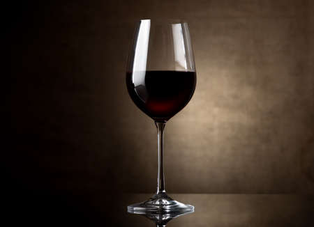 Glass of red wine on a dark background photo
