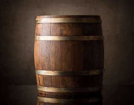 Old wooden barrel on a brown background