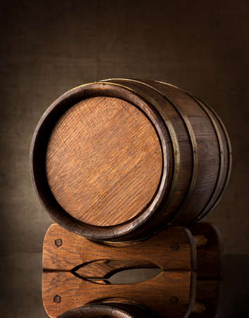 Old wooden barrel on a brown background photo