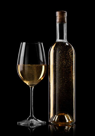 Bottle and glass of white wine on a black background