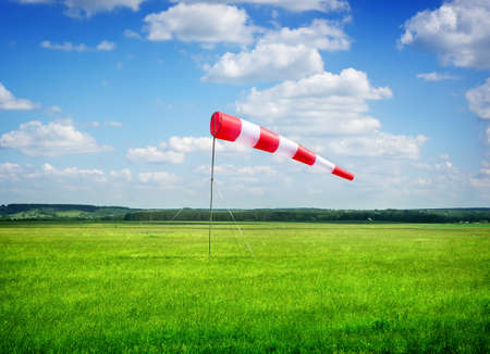 wind force: Air field direction sign and a wind force against the dark blue sky Stock Photo