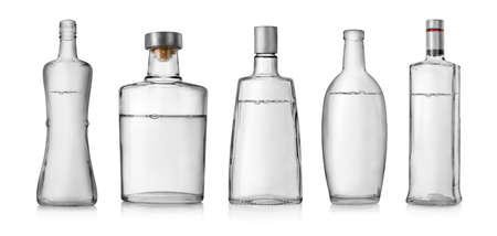 whiskey bottle: Collage of bottles of vodka isolated on a white background