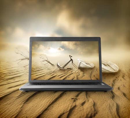 portative: Deserto sul monitor di un notebook portativo Archivio Fotografico