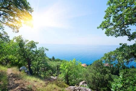 ���clear sky���: Sun and clear sky over the blue sea