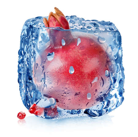 Pomegranate in ice cube isolated on white Stock Photo