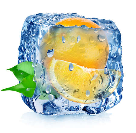 Orange in ice cube with drops isolated on white