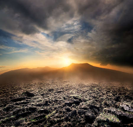 Plowed field in the mountains photo