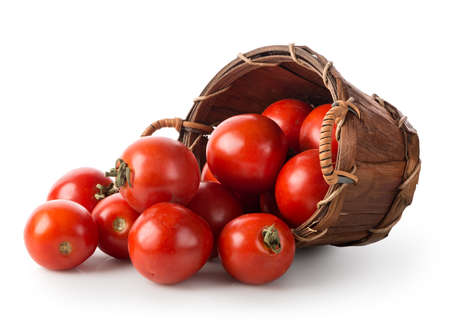 Tomatoes in a basket isolated on a white background Banco de Imagens