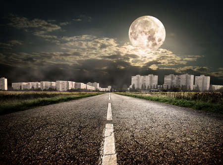 Highway to district under the moon. Elements of this image furnished by NASA photo