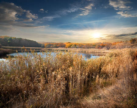 cloudy sky: Autumn river and reeds and cloudy sky Stock Photo