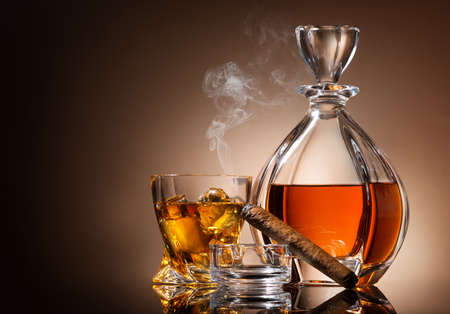warm drink: Decanter of whiskey with cigar and glass Stock Photo