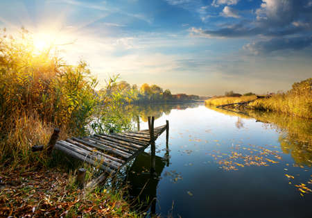 old pier: Old pier on autumn river at sunset