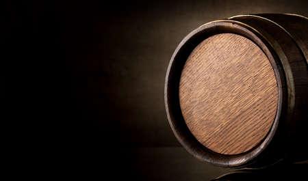 Wooden barrel on a background of brown texture Foto de archivo