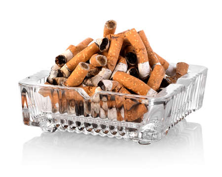 Heap of butts in a square ashtray photo