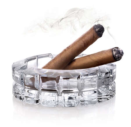 astray: Two cigars in a glass astray isolated on white Stock Photo