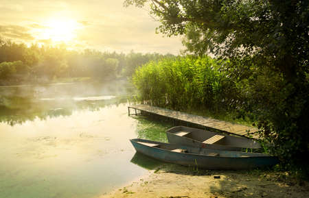 the lakes: Boats near pier at beautiful summer morning Stock Photo