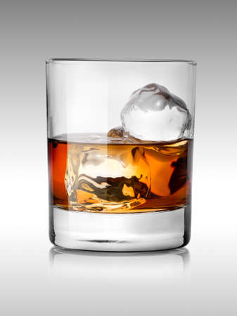 whiskey glass: Alcohol beverage with ice isolated on white