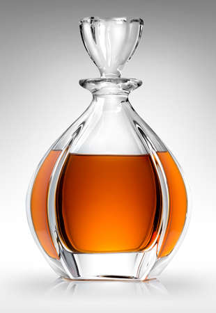 carafe: Carafe with whiskey on a gray background