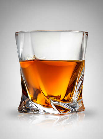 cognac: Glass of cognac on a gray background Stock Photo