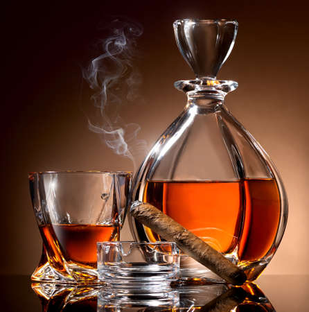 Decanter abd glass of alcohol and cigar on ashtray Stock Photo