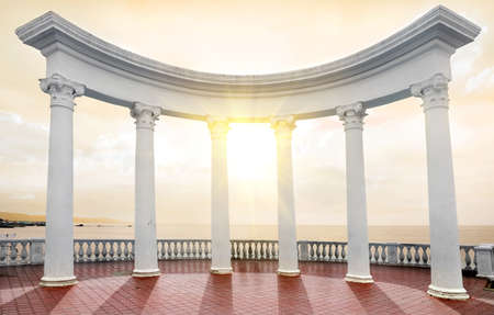 seafront: White arch with columns on a seafront Stock Photo