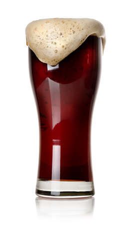Froth on black beer in glass isolated on white photo