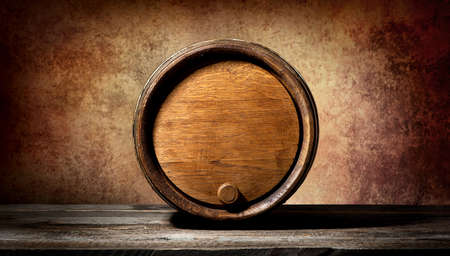 root beer: Barrel on a wooden table and brown background