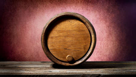 root beer: Wooden barrel on a textured pink background