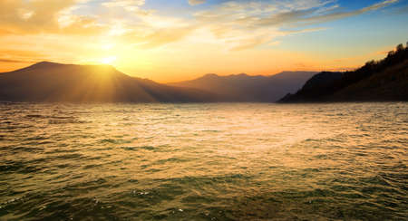 horison: Sea and high mountains at the sunrise