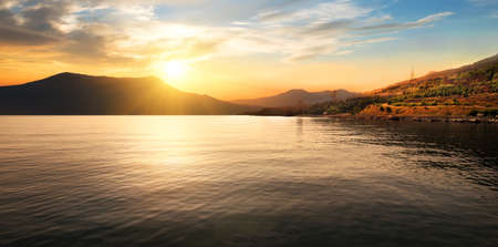 horison: Calm sea and mountains at the beautiful sunset Stock Photo