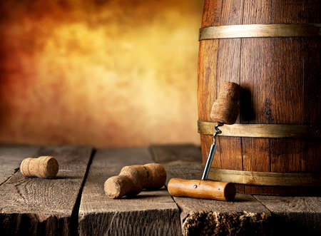 beer and wine: Barrel with wine and corkscrew on a wooden table Stock Photo
