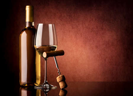 wine background: White wine and corkscrew on a vinous background