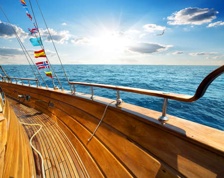 sea waves: Yacht in the sea at sunny day Stock Photo