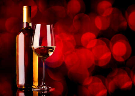 white wine: Festive white wine on a red background Stock Photo