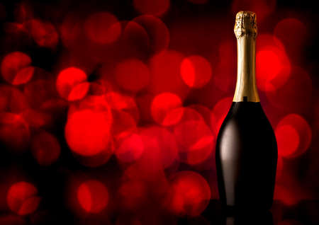wine glasses: Bottle of champagne on a red background