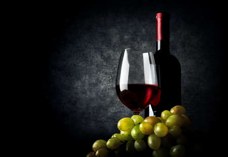 Wine with grape on a black background