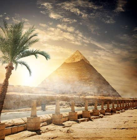 africa sunset: Pyramid of Khafre near road at sunlight