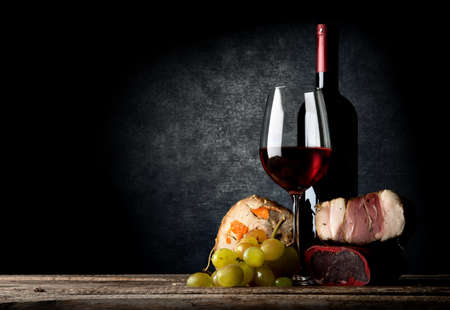 wooden table: Meat and red wine on a wooden table