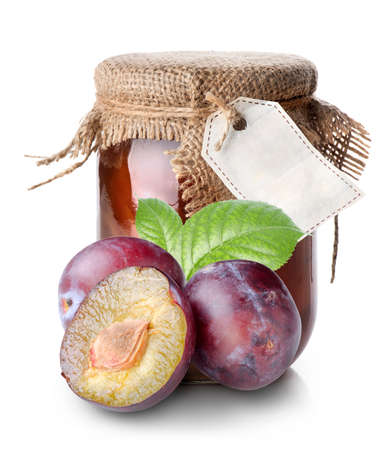 confiture: Plums and confiture in a jar isolated on white
