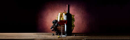 wicker bar: Wine with grape in basket on a vinous background