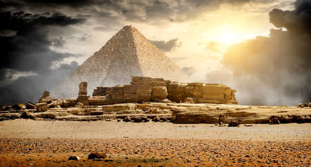 egyptian pyramids: Storm clouds over pyramid of Cheops in Giza