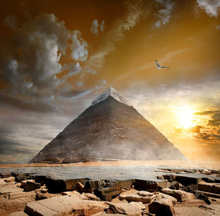 Pyramid of Khafre under storm clouds at sunset